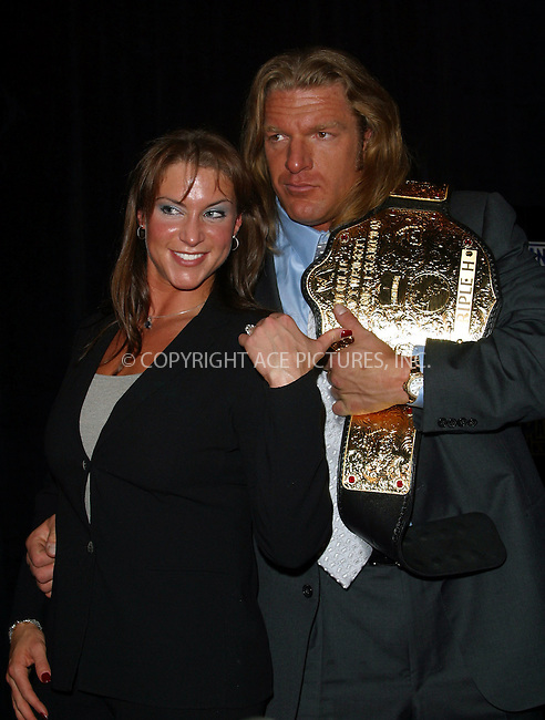 Press Conference Announcing Line-Up of WrestleMania XIX..PICTURED: Stephanie McMahon and Triple H. New York, March 18, 2003. Please byline: Alecsey Boldeskul/NY Photo Press.   ..*PAY-PER-USE*      ....NY Photo Press:  ..phone (646) 267-6913;   ..e-mail: info@nyphotopress.com
