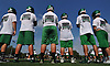 Farmingdale varsity football players participate in morning practice at Farmingdale High School on Tuesday, Aug. 16, 2016.