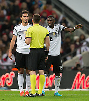 Mats Hummels (Bayern Munich) of Germany and Antonio Rudiger (Chelsea) of Germany complain to Referee  during the International Friendly match between England and Germany at Wembley Stadium, London, England on 10 November 2017. Photo by Andy Rowland.