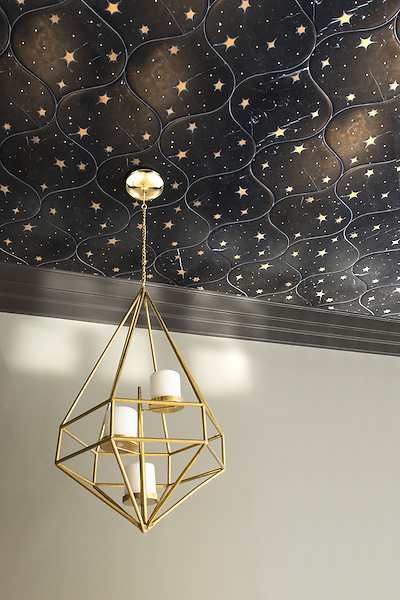 Astronomy, a waterjet stone mosaic, shown in Venetian honed Nero Marquina and Brass, is part of the Trove Collection for New Ravenna.