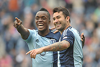 Mechack Jerome (24) defender Sporting KC and Claudio Bieler (16) forward Sporting KC celebrates Bieler's second goal..Sporting Kansas City defeated Chivas USA 4-0 at Sporting Park, Kansas City, Kansas.