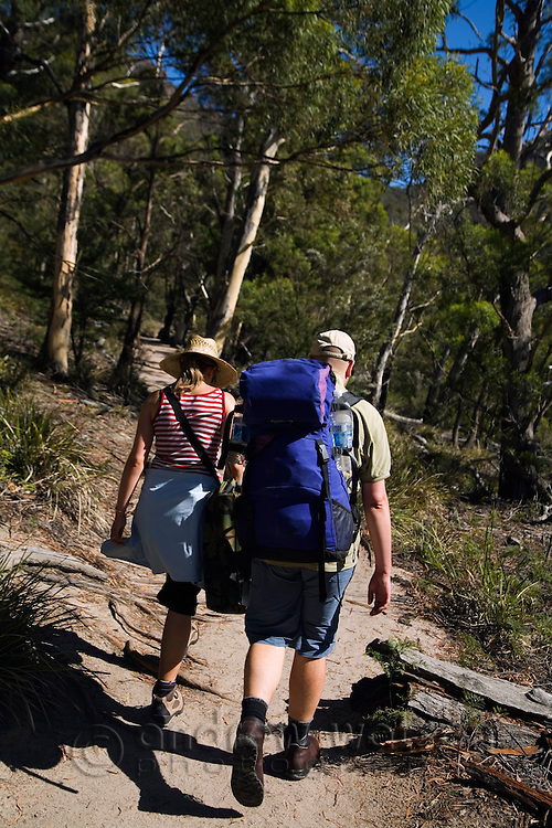 A couple hiking the peninsular trail near Wineglass Bay.  Freycinet National Park, Tasmania, AUSTRALIA