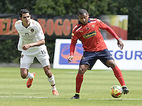 BOGOTÁ -COLOMBIA-06-09-2014. Norbey Salazar (Izq) jugador de Fortaleza FC disputa el balón con Jherson Córdoba (Der) jugador de Independiente Medellin por la fecha 8 de la Liga Postobón II 2014 jugado en el estadio Metropolitano de Techo en Bogotá./ Norbey Salazar (L) player of Fortaleza FC fights the ball with Jherson Córdoba (R) player of Independiente Medellin for the 8th date of Postobon League II 2014 played at Metropolitano de Techo stadium in Bogota. Photo: VizzorImage / Gabriel Aponte / Staff