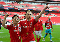 James Bree of Barnsley (left) and Marc Roberts  with their medals after winning the Johnstone's Paint Trophy Final match between Oxford United and Barnsley at Wembley Stadium, London, England on 3 April 2016. Photo by Alan  Stanford / PRiME Media Images.