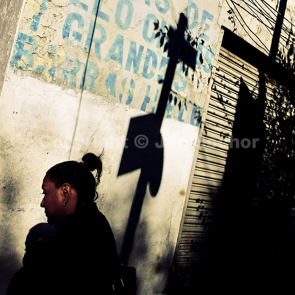 A Mexican woman walks around the street corner during a sunny morning in Buenavista, a neighborhood in Mexico City, Mexico, 29 October 2016.