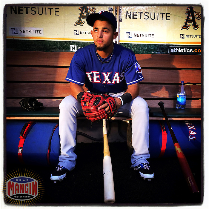 OAKLAND, CA - SEPTEMBER 17: Instagram of 20-year-old rookie Rougned Odor of Texas Rangers sitting in the dugout before the game against Oakland Athletics at O.co Coliseum on September 17, 2014 in Oakland, California. Photo by Brad Mangin