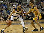 Nevada forward Cody Martin (11) is guarded by California Baptist guard Jeremy Smith (5) in the first half of an NCAA college basketball game in Reno, Nev., Monday, Nov. 19, 2018. (AP Photo/Tom R. Smedes)