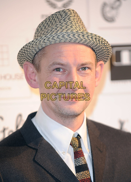 IAN HARTE .attending the Independent Film Awards 2009, The Brewery, Chiswell Street, London, England UK, .6th December 2009. .portrait headshot hat tie white shirt patterned pattern .CAP/BEL.©Tom Belcher/Capital Pictures.