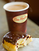 A Boston creme donut with coffee at a Tim Hortons restaurant in New Glasgow, Nova Scotia. Horton, who played hockey for the Toronto Maple Leafs, hailed from Nova Scotia - which accounts for the popularity of the chain.  On Nova Scotia, there are only two Starbucks shops, but 59 towns or villages are home to a Tim Hortons.  Photo by Kevin J. Miyazaki/Redux