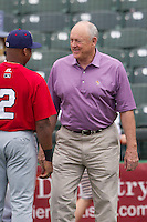 Round Rock Express Principal Owner and Hall of Famer Nolan Ryan chats with Oklahoma City Redhawks outfielder Adron Chambers #2 before the Pacific Coast League baseball game on April 3, 2014 at the Dell Diamond in Round Rock, Texas. The Redhawks defeated the Express 7-6 in the season opener for both teams. (Andrew Woolley/Four Seam Images)