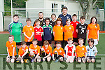 MEKD soccer club players with their coaches Pa Murphy and Liam Murphy who were presented medals at the clubs awards in Fossa on Saturday