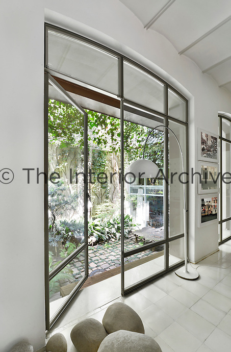 A full height glass door that leads to a garden beyond.