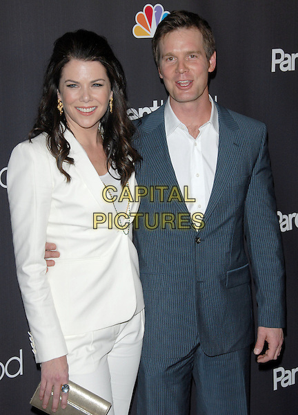 """LAUREN GRAHAM & PETER KRAUSE .at the NBC Universal's """"Parenthood"""" Premiere Screening held at The DGA in West Hollywood, California, USA..February 22nd, 2010                      .half length white jacket suit blue grey gray.CAP/RKE/DVS.©DVS/RockinExposures/Capital Pictures."""