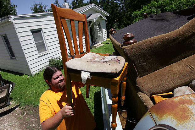 Alex Ervanian loads furniture while helping evacuate his friend Brad Teal's house on Hillside Avenue near the Des Moines River south of downtown Friday, June 13, 2008.