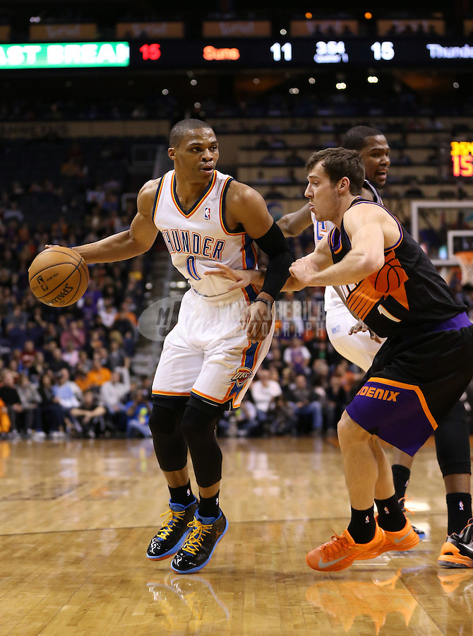 Feb. 10, 2013; Phoenix, AZ, USA: Oklahoma City Thunder point guard Russell Westbrook (0) against Phoenix Suns point guard Goran Dragic (1) at the US Airways Center. Mandatory Credit: Mark J. Rebilas-