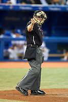 Umpire Jerry Meals makes a call during an American League game between the Toronto Blue Jays and Seattle Mariners at the Rogers Centre on September 13, 2012 in Toronto, Ontario.  Toronto defeated Seattle 8-3.  (Mike Janes/Four Seam Images)