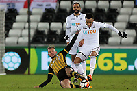 Martin Olsson of Swansea City (R) is tackled by Jordan Rhodes of Sheffield Wednesday (L) for which he saw a yellow card during The Emirates FA Cup Fifth Round Replay match between Swansea City and Sheffield Wednesday at the Liberty Stadium, Swansea, Wales, UK. Tuesday 27 February 2018