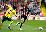 Chris Basham of Sheffield Utd glides past Josh Murphy of Norwich City during the Championship match at Bramall Lane Stadium, Sheffield. Picture date 16th September 2017. Picture credit should read: Simon Bellis/Sportimage