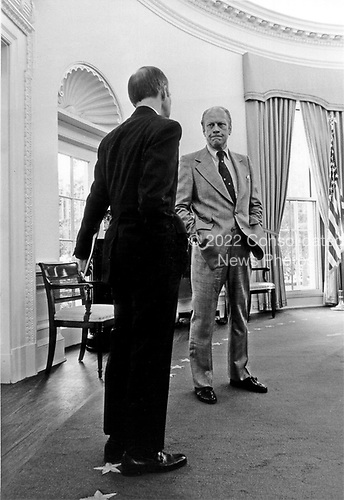 The mood is sombre as United States President Gerald R. Ford confers in the Oval Office in the White House in Washington, D.C. on October 1, 1974 with Brent Scowcroft, Deputy Assistant to the President for National Security Affairs, on a foreign policy problem.<br /> Mandatory Credit: David Hume Kennerly / White House via CNP