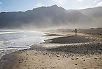 Atlantic Ocean coast beach and waves with morning sea mist, Caleta de Famara, Lanzarote, Canary islands, Spain