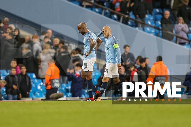 Fabien DELPH of Manchester City and David DAVID SILVA of Manchester City look dejected after the UEFA Champions League match between Manchester City and Olympique Lyonnais at the Etihad Stadium, Manchester, England on 19 September 2018. Photo by David Horn / PRiME Media Images.