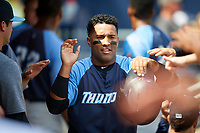 Trenton Thunder shortstop Wendell Rijo (12) high fives with his teammates in the dugout during a game against the Hartford Yard Goats on August 26, 2018 at Dunkin' Donuts Park in Hartford, Connecticut.  Trenton defeated Hartford 8-3.  (Mike Janes/Four Seam Images)