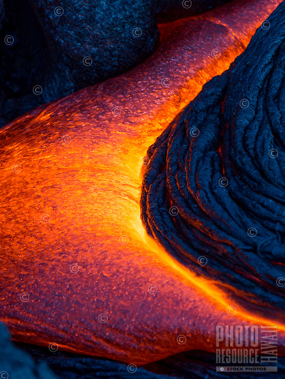 Crescent Lava Flow: Lava oozes out of a rock in a crescent moon shape, Kalapana, Hawai'i Island.