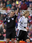 Referee Martin Atkinson shows Derby's Robbie Savage a yellow card for foul. during the Premier League match at the Riverside Stadium, Middlesbrough. Picture date 8th March 2008. Picture credit should read: Richard Lee/Sportimage