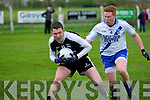 Cian Hussey (Ardfert) in action with Darragh O'Sullivan (St Mary's) in the County Intermediate Football Championship round 1 at Ardfert on Saturday evening.