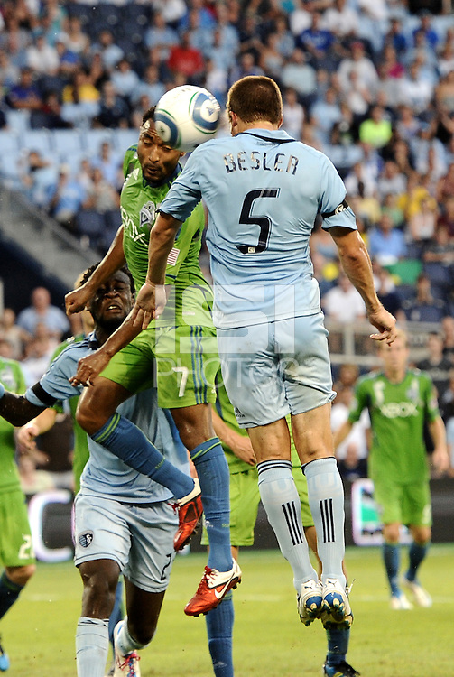 James Riley (7) defender Seattle Sounders and Matt Besler (5) defender Sporting KC go up for a header..... Sporting Kansas City were defeated 1-2 by Seattle Sounders at LIVESTRONG Sporting Park, Kansas City, Kansas.