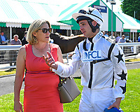 Jockey Charles Bishop talks through his race with trainer Eve Johnson Houghton during Whitsbury Manor Stud Bibury Cup Day Racing at Salisbury Racecourse on 27th June 2018