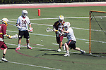 Orange, CA 05/02/10 - Matt Sathrum (Chapman # 16) stops a shot on goal as Spencer Halvorsen (Chapman # 30) and Eric Nelson (ASU # 13) look on uring the Chapman-Arizona State MCLA SLC Division I final at Wilson Field on Chapman University's campus.  Arizona State defeated Chapman 13-12 in overtime.