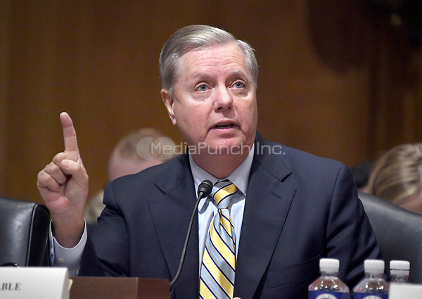 United States Senator Lindsey Graham (Republican of South Carolina) testifies before the US Senate Committee on Finance &quot;Hearing to Consider the Graham-Cassidy-Heller-Johnson Proposal&quot; on the repeal and replace of the Affordable Care Act (ACA) also known as &quot;ObamaCare&quot; in Washington, DC on Monday, September 25, 2017.  Graham is the lead author of the bill.<br /> Credit: Ron Sachs / CNP /MediaPunch