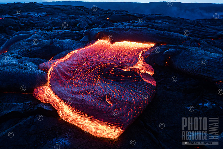 More Blue Lava Curl: Dusk reflects blue light over cooling black lava on the surface of molten lava flowing in Pulama Pali (of Holei Pali), Hawai'i Volcanoes National Park, Puna, Hawai'i Island, September 2017.