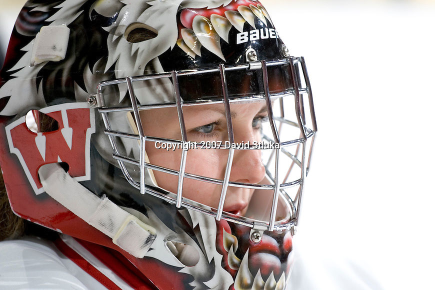 MADISON, WI - FEBRUARY 16: Goalie Jessie Vetter #30 of the Wisconsin Badgers women's hockey team looks on prior to the game against the Bemidji State Beavers at the Kohl Center on February 16, 2007 in Madison, Wisconsin. The Badgers beat the Beavers 2-0. (Photo by David Stluka)