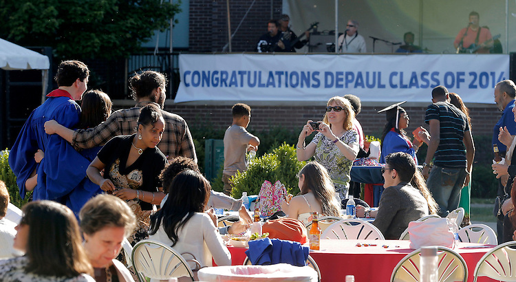 Students gather with their friends and family on The Quad at DePaul University's Lincoln Park Campus for the annual Commencement Kick-Off Friday, June 13, 2014. (DePaul University/Jamie Moncrief)