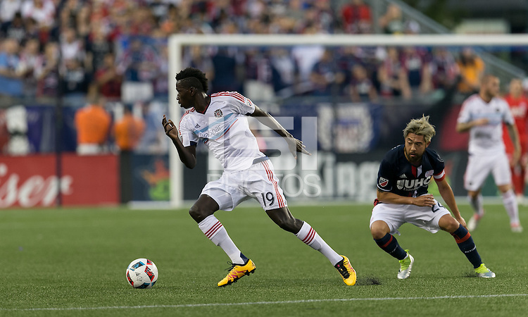 Foxborough, Massachusetts - July 23, 2016: First half action. In a Major League Soccer (MLS) match, the New England Revolution (blue/white) vs Chicago Fire (white), at Gillette Stadium.