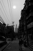 Daytime vertical view of a small side road in the Guǎnchéng Huízú Qū of Zhengzhou in Henan province.  © LAN