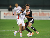 Washington D.C. - April 5, 2014:  Andrew Farrell from the New England Revolution shields the ball against Lewis Neal  of D. C. United.  D.C. United defeated 2-0 the New England Revolution during a Major League Soccer match for the 2014 season at RFK Stadium.