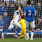 Graeme Shinnie celebrates scoring from the penalty spot