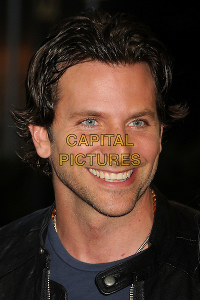 "Bradley Cooper.""Hit and Run"" Los Angeles Premiere held at Regal Cinemas L.A. Live, Los Angeles, California, USA..August 14th, 2012.headshot portrait blue black leather stubble facial hair smiling.CAP/ADM/BP.©Byron Purvis/AdMedia/Capital Pictures."