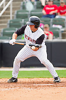Kevin Dubler #27 of the Kannapolis Intimidators attempts to bunt against the West Virginia Power at Fieldcrest Cannon Stadium on April 20, 2011 in Kannapolis, North Carolina.   Photo by Brian Westerholt / Four Seam Images