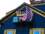 Decorated fire escape shutters on a Newport house along Thames St. in Newport, R.I. (Photo/Joe Giblin) no release
