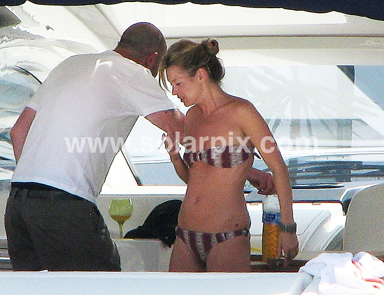 **ALL-ROUND EXCLUSIVE PICTURES FROM SOLARPIX.COM**.**SYNDICATION RIGHTS FOR UK, AUSTRALIA & N.Z,  SOUTH AFRICA & RUSSIA**.Kate Moss was looking relaxed and very much the girl next door as she lounged on the back of a motor yacht in the Spanish Med with friends. The group spent the day eating and drinking while Kate oiled her self up before sunbathing on the back of the boat..JOB REF:   6767     MAD / ROJ       DATE:  03.07.08.**MUST CREDIT SOLARPIX.COM OR DOUBLE FEE WILL BE CHARGED* *UNDER NO CIRCUMSTANCES IS THIS IMAGE TO BE REPRODUCED FOR ANY ONLINE EDITION WITHOUT PRIOR PERMISSION*