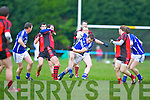 Raymond O'Connor Glenbeigh/Glencar bounces off of Maurice Foley Laune Rangers during the Mid Kerry Championship final in Beaufort on Saturday