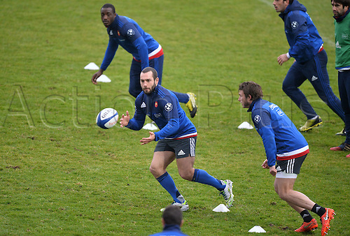 23.02.2016. CNR Marcoussis, Paris, France. The French nationaol rugby team at practise before their 6 Nations game against Wales on 25th February 2016.  Jean Marc Doussain (fra) and Djibril Camara (fra) - Maxime Medard (fra)