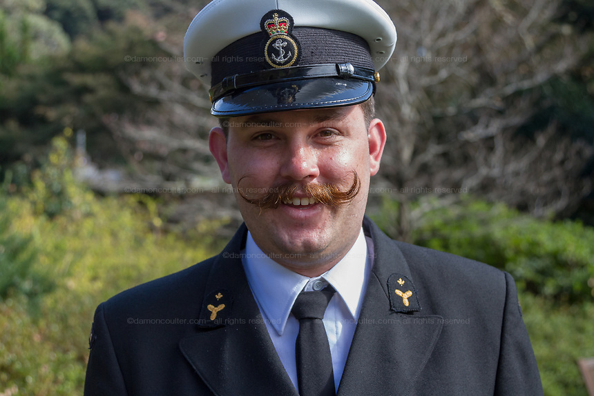 A Canadian sailor from Frigate, HMCS Calgary with a fancy moustache  during the Remembrance Sunday ceremony at the Hodogaya, Commonwealth War Graves Cemetery in Hodogaya, Yokohama, Kanagawa, Japan. Sunday November 11th 2018. The Hodagaya Cemetery holds the remains of more than 1500 servicemen and women, from the Commonwealth but also from Holland and the United States, who died as prisoners of war or during the Allied occupation of Japan. Each year officials from the British and Commonwealth embassies, the British Legion and the British Chamber of Commerce honour the dead at a ceremony in this beautiful cemetery. The year 2018 marks the centenary of the end of the First World War in 1918.