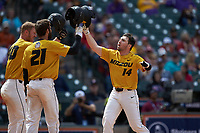 Alex Peterson (14) of the Missouri Tigers is greeted at home plate by teammates Brandt Belk (21) and Peter Zimmermann (40) after hitting a home run against the Oklahoma Sooners in game four of the 2020 Shriners Hospitals for Children College Classic at Minute Maid Park on February 29, 2020 in Houston, Texas. The Tigers defeated the Sooners 8-7. (Brian Westerholt/Four Seam Images)