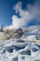 "Steam and snow combine with the ""Devil's Thumb"" at Palette Spring for a dramatic winter landscape-Mammoth Hot Springs"