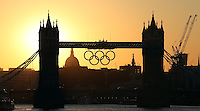 23.07.2012. London England. Sunset with the Olympic rings on the tower bridge in London, Great Britain, 23 July 2012. The London 2012 Olympic Games will start on 27 July 2012.